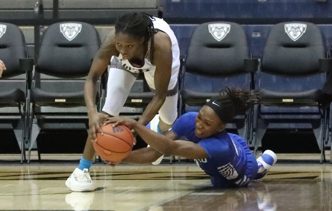 Buffalo Bulls guard Theresa Onwuka (11) battles St. Bonaventure Bonnies guard Asianae Johnson (2) for the ball on the floor in the fourth quarter at the Reilly Center at  St. Bonaventure in Olean, NY on Saturday, Dec. 7, 2019.  (James P. McCoy/Buffalo News)