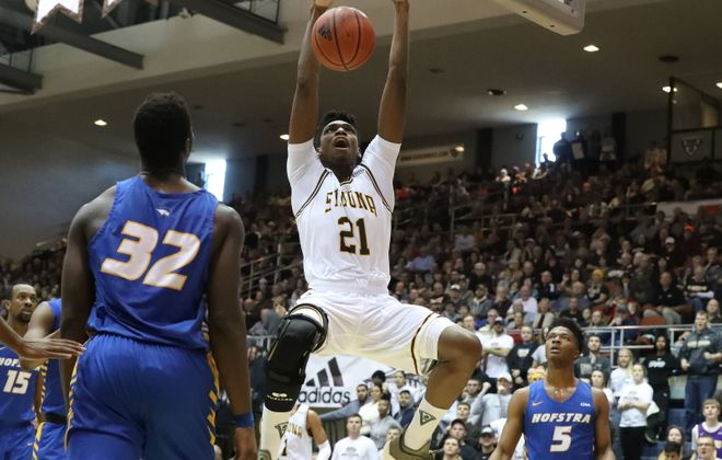 St. Bonaventure Bonnies center Osun Osunniyi (21) scores two points over Hofstra Pride forward Isaac Kante (32) at the Reilly Center at St. Bonaventure on Saturday, Dec. 7, 2019. (James P. McCoy/Buffalo News)