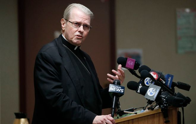 Bishop Edward B. Scharfenberger speaks with reporters at the Catholic Center in Buffalo in December.        (Mark Mulville/News file photo)