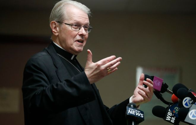 Albany Bishop Edward B. Scharfenberger speaks with reporters on Wednesday after the announcement that he would become the interim leader of the Catholic Diocese of Buffalo. (Mark Mulville/Buffalo News)
