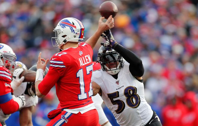Baltimore Ravens linebacker L.J. Fort (58) pressures Buffalo Bills quarterback Josh Allen (17) in the second quarter  Sunday during the Bills 24-17 loss to the Baltimore Ravens. (Mark Mulville/Buffalo News)