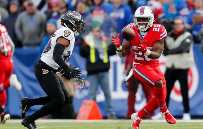 Bills running back Devin Singletary (26) makes a catch on Baltimore Ravens defensive back Chuck Clark in the second quarter. (Mark Mulville/Buffalo News)