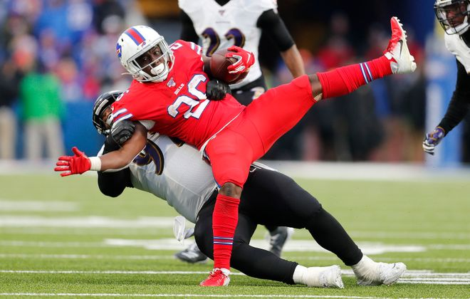 Bills running back Devin Singletary is brought down hard by Baltimore Ravens defensive tackle Michael Pierce in the fourth quarter. (Mark Mulville/Buffalo News)