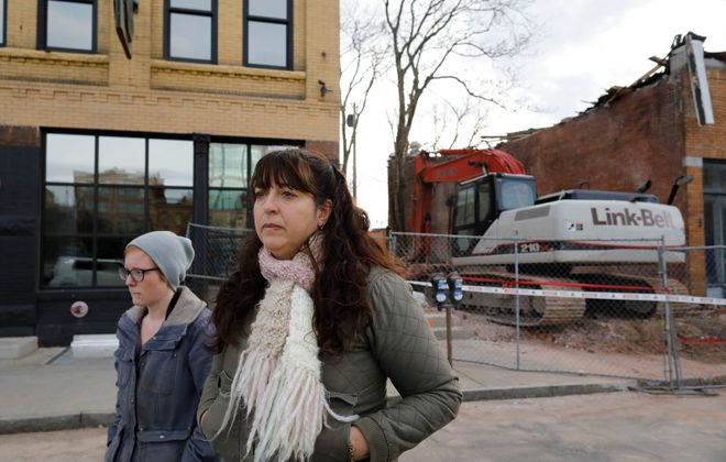 Susan Adamucci, owner of Two Wheels Bakery & Cafe, filed a claim in State Supreme Court against Buffalo Properties, a Nyack, N.Y.-based company whose failure to fix structural problems led to the building's emergency demolition and the closing of the bakery. (Derek Gee/Buffalo News)