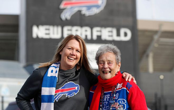 Donna Crum and her mother, Joan Daboll Hoak, outside New Era Field before the Bills-Ravens game. (Mark Mulville/Buffalo News)