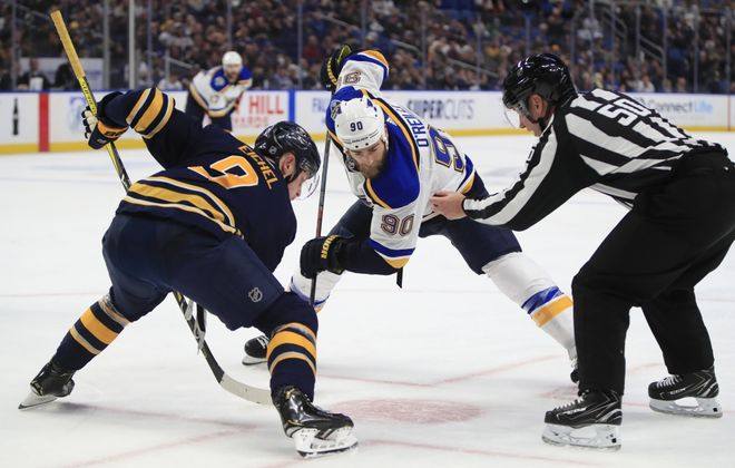 Buffalo Sabres center Jack Eichel and St. Louis Blues  Ryan O'Reilly during a faceoff during the second period at the KeyBank Center, on Tuesday, Dec. 10, 2019.  (Harry Scull Jr./Buffalo News)