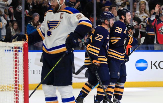 Buffalo Sabres foward Johan Larsson congratulates Zemgus Girgensons on his empty net goal against as St. Louis captain Alex Pietrangelo ponders his club's fate. (Harry Scull Jr./Buffalo News)