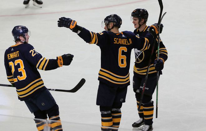 Buffalo Sabres' Marco Scandella celebrates a goal with Sam Reinhart (23) and Henri Jokiharju (10) against Los Angeles Kings in second period action at KeyBank Center on Saturday, Dec. 21, 2019. (John Hickey/Buffalo News)