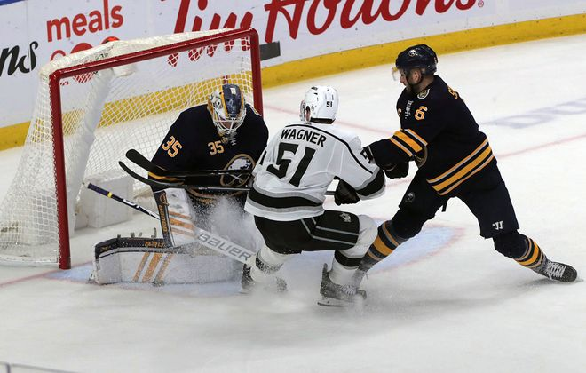 Buffalo Sabres goalie Linus Ullmark stops a shot by Los Angeles Kings' Austin Wagner as Sabres' Marco Scandella (6) moves in during third period action at KeyBank Center on Saturday, Dec. 21, 2019. (John Hickey/Buffalo News)