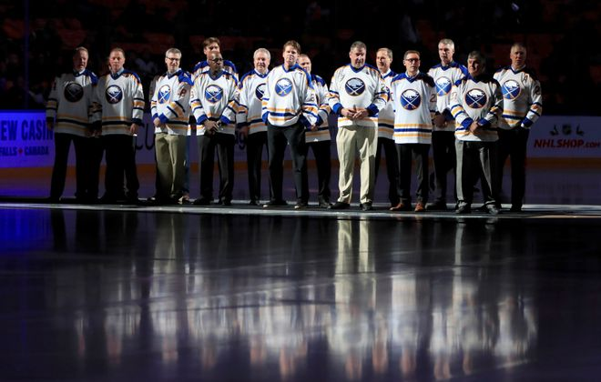 Buffalo Sabres alumni from the 1980s stand at center ice prior to first period action against the Nashville Predators at the KeyBank Center on Thursday, Dec. 12, 2019.  (Harry Scull Jr./Buffalo News)