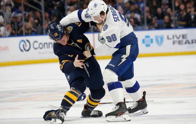 Buffalo Sabres defenseman Jake McCabe (19) fights with Tampa Bay Lightning defenseman Mikhail Sergachev (98) during the second period at KeyBank Center, Tuesday, Dec. 31, 2019. (Derek Gee/Buffalo News)