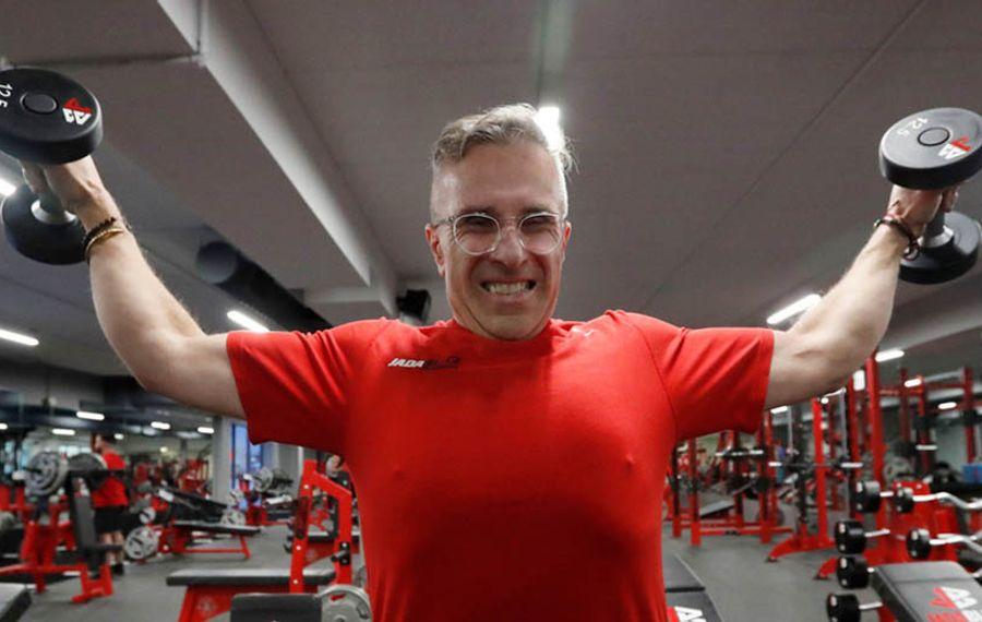 John Prisaznuk, 56, of Cheektowaga, has lost 175 pounds using a comprehensive strategy based on diet and fitness. (Sharon Cantillon/Buffalo News)