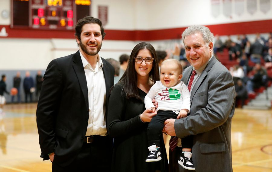 Bishop Timon-St. Jude's Joe Licata, his sister and Starpoint assistant Grace, and their dad and Starpoint head coach Gil Licata share a moment with 9-month old Vinny, Gil's grandson, before the start of Friday's varsity basketball game featuring Timon-St. Jude versus Starpoint. (Mark Mulville/Buffalo News)