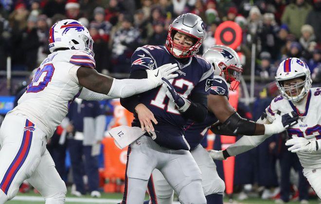 Bills defensive end Shaq Lawson pressures Patriots quarterback Tom Brady. (James P. McCoy/Buffalo News)