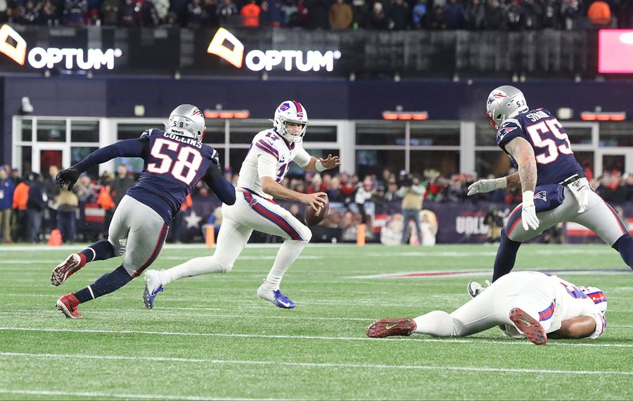 Buffalo Bills quarterback Josh Allen (17) is pressured by New England Patriots outside linebacker Jamie Collins (58) one the Bills' final play in the fourth quarter at Gillette Stadium on Saturday, Dec. 21, 2019. (James P. McCoy/Buffalo News)