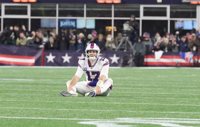 Buffalo Bills quarterback Josh Allen (17) sits on the turf after New England Patriots cornerback J.C. Jackson (27) knocked down a pass intended for Buffalo Bills wide receiver Cole Beasley (10) on the Bills final play in the second quarter at Gillette Stadium in Foxborough, MA on Saturday, Dec. 21, 2019.  James P. McCoy/Buffalo News