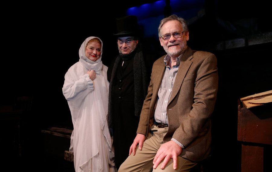 """Neal Radice, founder and executive director of Alleyway Theatre, has directed """"A Christmas Carol"""" for 37 years. Radice is retiring from the top job at Alleyway at the end of the season. From left, just before last Thursday's performance, he is shown with Joyce Stilson as the Ghost of Christmas Past and David Mitchell as Ebenezer Scrooge. (Sharon Cantillon/Buffalo News)"""