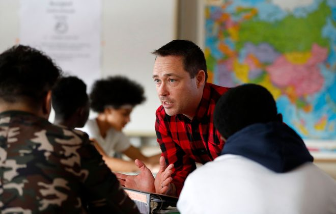 John Venne teaches his students about the history of impeachment - which now includes  President Donald Trump - Thursday in his American government and politics class at Burgard High School. (Mark Mulville/Buffalo News)