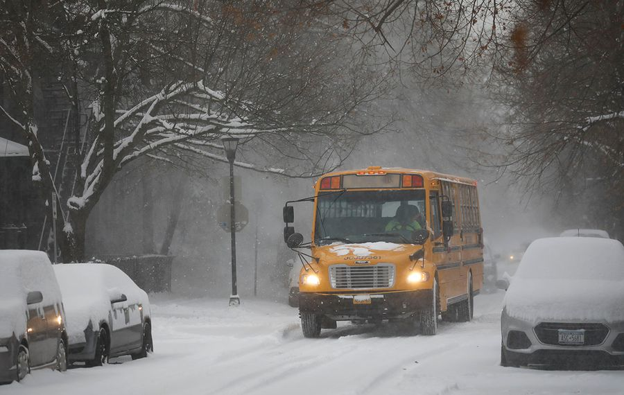 A school bus picks up students in the Elmwood Village as snow falls, Wednesday, Dec. 11, 2019. (Derek Gee/Buffalo News)
