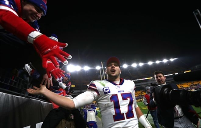 Josh Allen is congratulated by fans after the Bills' win against Pittsburgh. (James P. McCoy / Buffalo News)