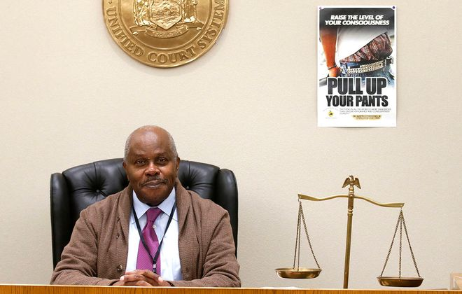 """Retired City Court Judge James A.W. McLeod put up the """"Pull Up Your Pants"""" poster to try to make young defendants think about the consequences of their behavior and how they present themselves. (Robert Kirkham/Buffalo News)"""