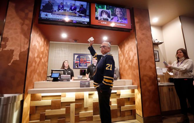 Rickey Armstrong Sr., president of the Seneca Nation, holds up the first bet placed at the new Seneca Buffalo Creek Casino sports lounge on Dec. 13, 2019. (Mark Mulville/News file photo)