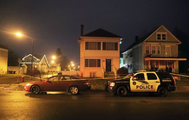 Buffalo police investigate at the corner of Northland Avenue and Lonsdale Road in Buffalo after a police-involved shooting  on Monday, Dec. 30, 2019. (John Hickey/Buffalo News)