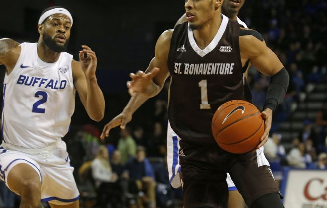 St. Bonaventure's Dominick Welch (1) drives under the hoop near UB's Antwain Johnson (2) during a game at Alumni Arena on Dec. 30, 2019. (Robert Kirkham/News file photo)