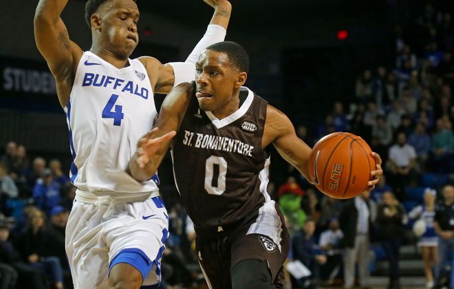 UB's Davonta Jordan (4) tries his best to shut down Bona's Kyle Lofton (0) at UB's Alumni Arena where the Bulls hosted the St. Bonaventure Bonnies on Monday, Dec. 30, 2019. (Robert Kirkham/Buffalo News)