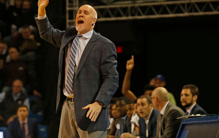 Bona's Coach Mark Schmidt rallies his team during basketball action at UB's Alumni Arena where the University at Buffalo Bulls hosted the St. Bonaventure Bonnies on Monday, Dec. 30, 2019. (Robert Kirkham/Buffalo News)