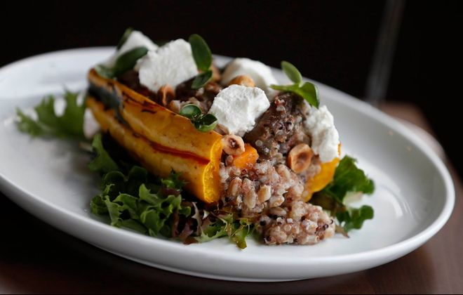 Inizio's zucca ripieni is delicata squash stuffed with whole-grain porridge, mushrooms, hazelnuts and goat cheese. (Sharon Cantillon/Buffalo News)