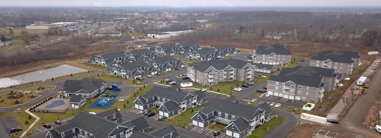Some believe the noise may be from a resident who is protesting development, possibly the Heron Pointe apartment complex pictured here. The project is in the area where the booms are most commonly heard. (John Hickey/Buffalo News)