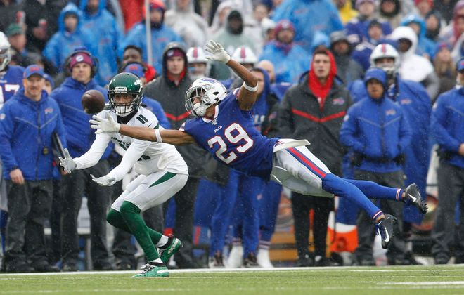 Bills cornerback Kevin Johnson dives to break up a pass against the New York Jets on Sunday. (Derek Gee/Buffalo News)