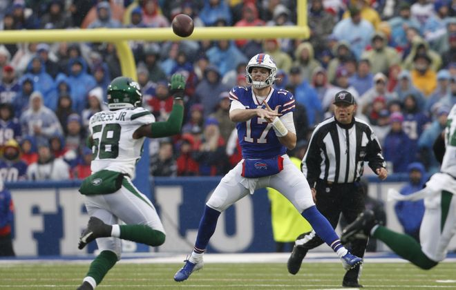 Bills quarterback Josh Allen throws the ball on the run against the Jets during the first quarter (Derek Gee/Buffalo News)