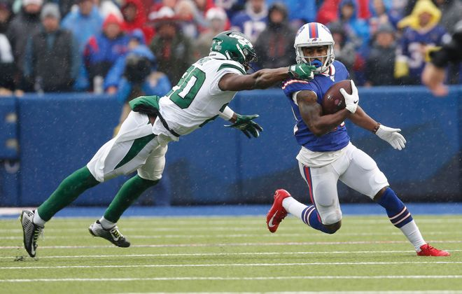 New York Jets free safety Marcus Maye (20) grabs the face mask of Buffalo Bills wide receiver Isaiah McKenzie (19) during the first quarter at New Era Field in Orchard Park, Sunday, Dec. 29, 2019. (Derek Gee/Buffalo News)