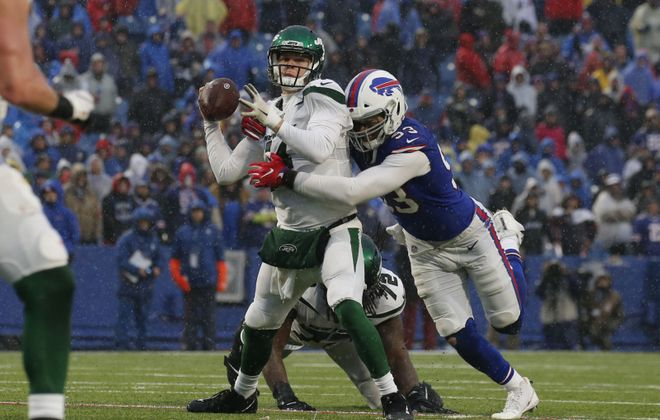 New York Jets quarterback Sam Darnold is sacked by Buffalo Bills defensive end Trent Murphy during the second quarter. (Derek Gee/Buffalo News)