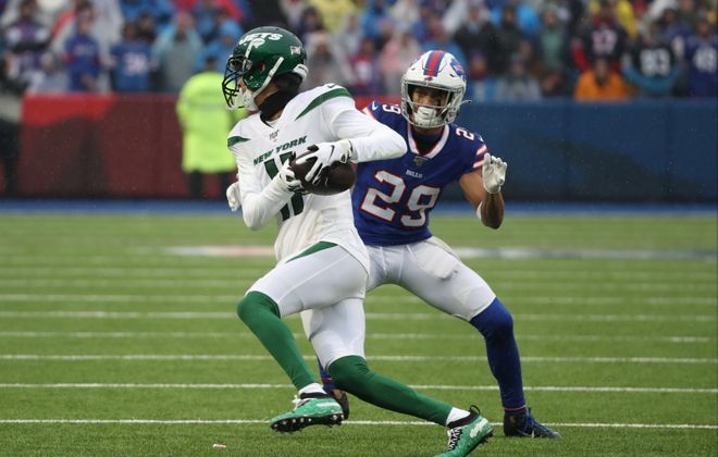 Bills cornerback Kevin Johnson tackles New York Jets wide receiver Robby Anderson in the first quarter (James P. McCoy/Buffalo News)