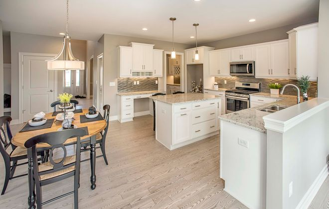 The Essex model home in the Northwoods community is located at 5379 Briannas Nook just off Marguerites Way, past the intersection of Roll and Shimerville Roads.