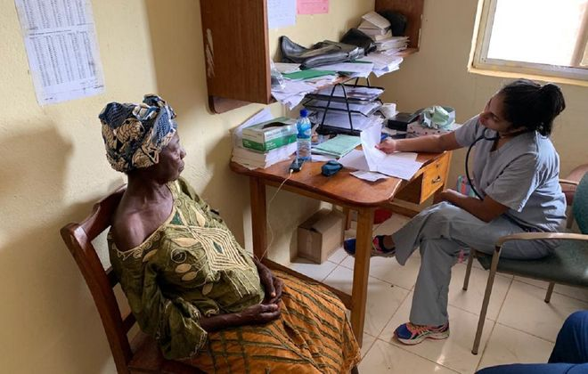 Erie County Medical Center ER nurse Amanda Buzynski, right, spent most of her recent trip to West Africa in central Sierra Leone, at the Adama Martha Memorial Community Health Center. (Photo courtesy of Amanda Buzynski)