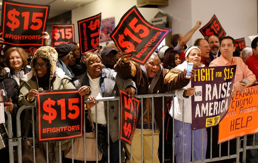 Protesters press for a higher minimum wage outside the Empire State Plaza Convention Center in Albany in 2016. An ongoing boost in the state's minimum wage cost the state $700 million this year to cover the wages of Medicaid-reimbursed health workers. (Derek Gee/News file photo)