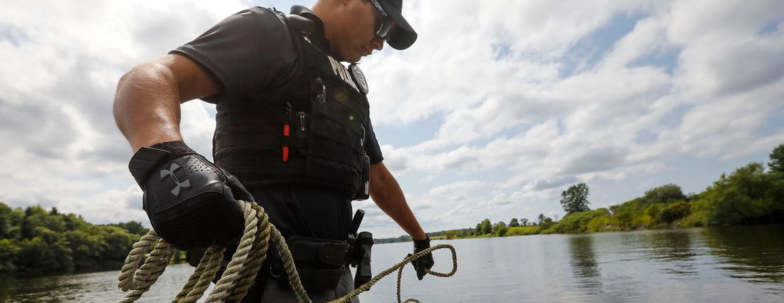 St. Regis Mohawk Tribal Police Patrolman Barnes prepares lines from the bow of a Tribal Police watercraft on patrol in the Grasse River on the Akwesasne Mohawk Nation, Friday, Aug. 16, 2019. (Derek Gee/Buffalo News)