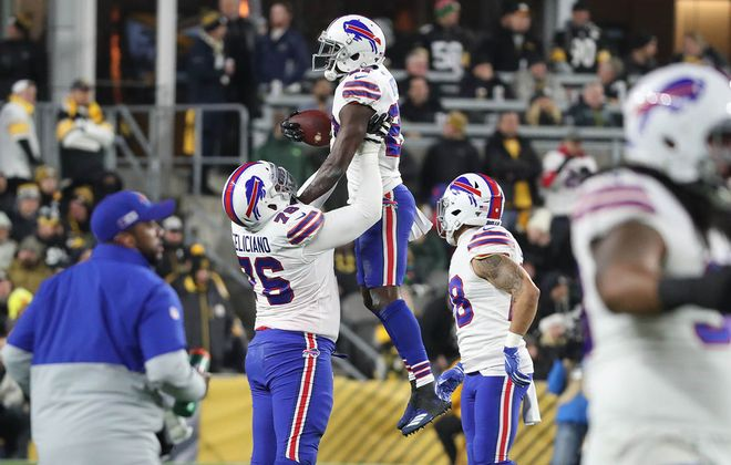 Bills offensive guard Jon Feliciano (76) lifts cornerback Tre'Davious White (27) after White caught an interception against the Pittsburgh Steelers in the first quarter Sunday at Heinz Field in Pittsburgh. (James P. McCoy/Buffalo News)