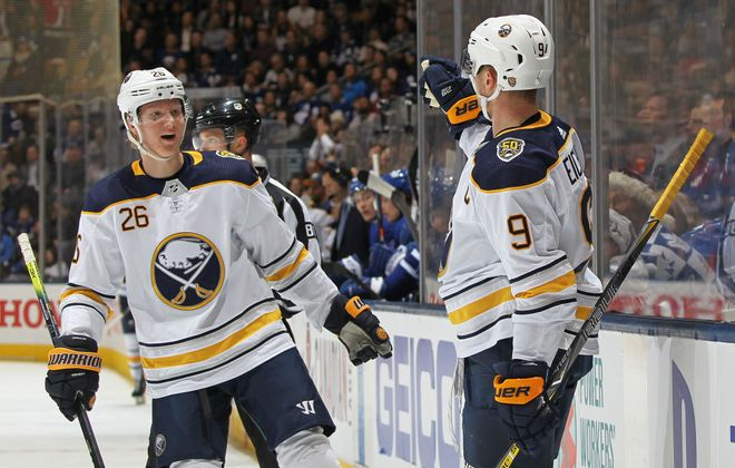 Buffalo Sabres center Jack Eichel celebrates his goal with teammate Rasmus Dahlin against the Toronto Maple Leafs at Scotiabank Arena in Toronto. (Getty Images)