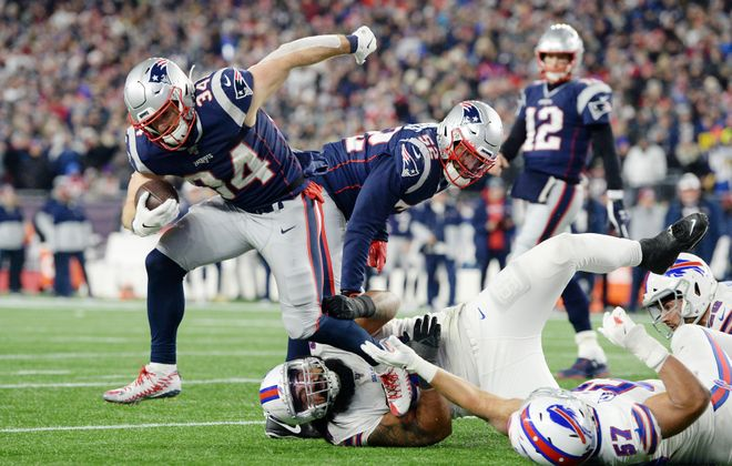 The Buffalo Bills' defense had a difficult time finishing tackles Saturday, like on this run by Patriots running back Rex Burkhead. (Getty Images)