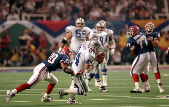 Bills safety Henry Jones tackles Cowboys' Jay Novacek during Super Bowl XXVIII at the Georgia Dome. (Getty Images)