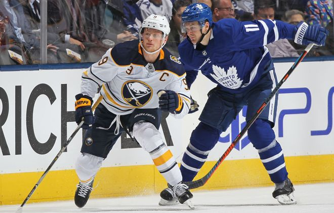 Jack Eichel works against Toronto's Zach Hyman during Tuesday night's game in Scotiabank Arena. (Getty Images)