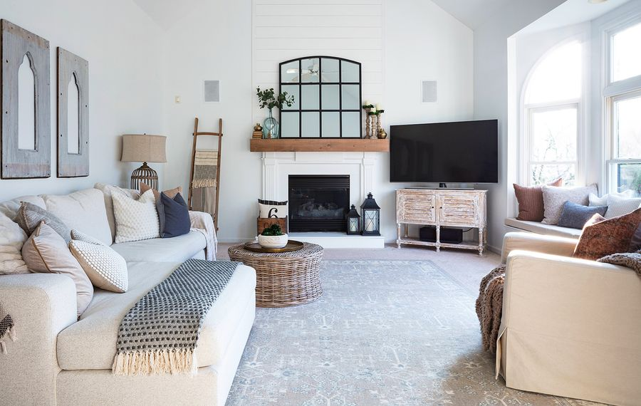 Vanessa Fermani's living room is filled with thoughtful DIY touches, including the chapel windows above the sofa she whitewashed. Her plethora of pillows are a mix of Target, Home Goods and her store, Nigh Road Farmhouse. Her sofa and rug are from Pottery Barn. (Lindsay Sisting)