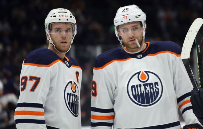 Edmonton's Connor McDavid, left, and Leon Draisaitl are the NHL's top two scorers. (Getty Images)