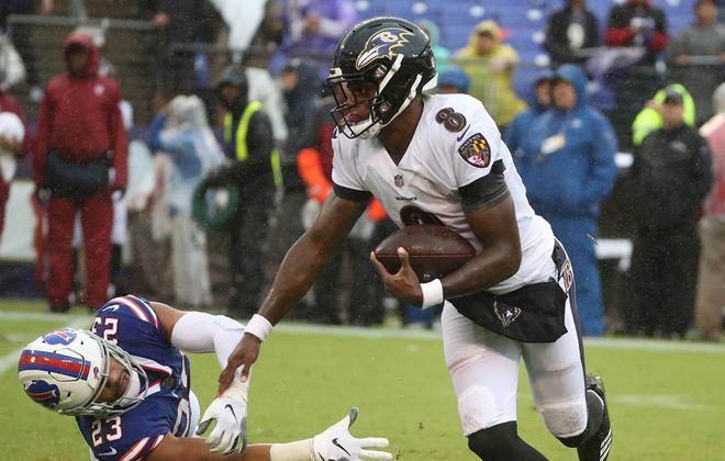 Ravens QB Lamar Jackson (8) beats Bills defensive back Micah Hyde (23) for a first down Sept. 9, 2018, at M&T Bank Stadium in Baltimore. (James P. McCoy/News file photo)