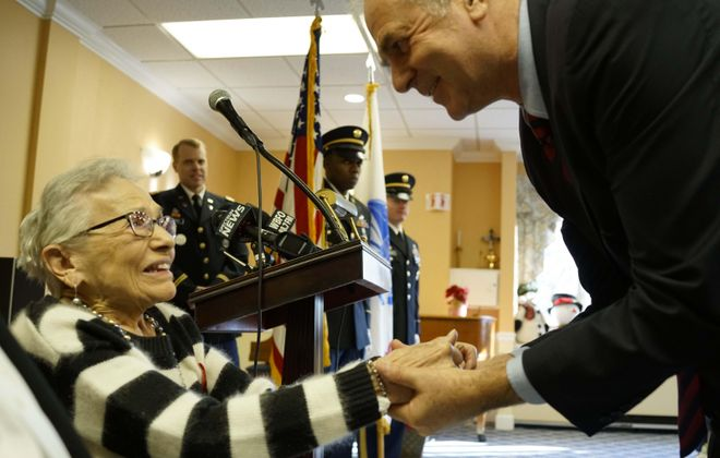 World War II veteran Mildred Speers, 98, talks with Honorary French Consul Pascal Soares after he presented her with the French Chevalier Legion of Honor Medal. (Derek Gee/Buffalo News)